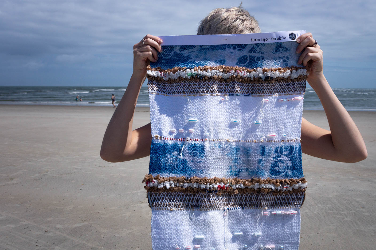"""Compilation, Approximately 15""""x 40"""", floor loom weaving, cotton, plastic bags, straws, rubber bands, cyanotype"""
